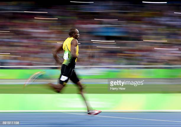 Usain Bolt of Jamaica races to a gold medal during the men's 200 meter final at Olympic Stadium on August 18, 2016 in Rio de Janeiro, Brazil.