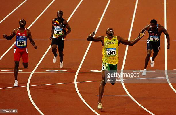 Usain Bolt of Jamaica reacts after breaking the world record with a time of 1930 to win the gold medal in the Men's 200m Final ahead of Churandy...