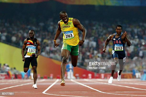 Usain Bolt of Jamaica reacts after breaking the world record with a time of 1930 to win the gold medal in the Men's 200m Final ahead of Antilles...