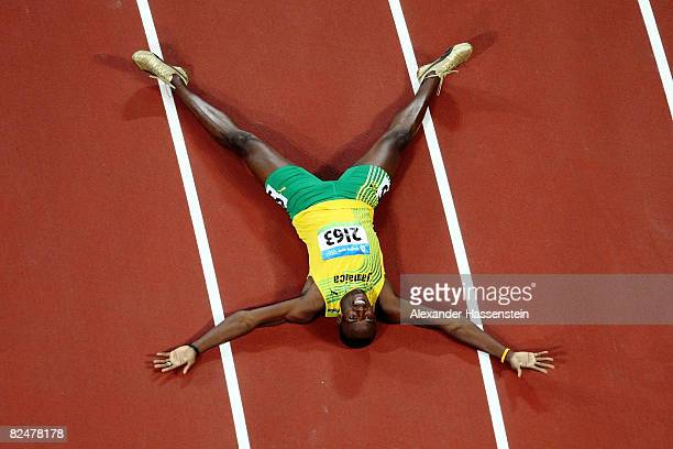 Usain Bolt of Jamaica reacts after breaking the world record with a time of 1930 seconds to win the gold medal in the Men's 200m Final at the...