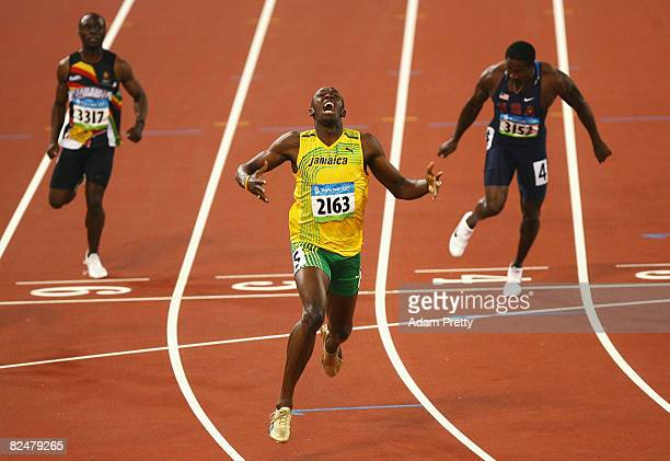 Usain Bolt of Jamaica reacts after breaking the world record with a time of 19.30 to win the gold medal in the Men's 200m Final ahead of Brian...