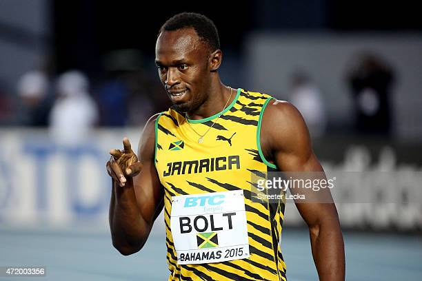 Usain Bolt of Jamaica reacts after competing in round one of the men's 4 x 100 metres on day one of the IAAF World Relays at Thomas Robinson Stadium...