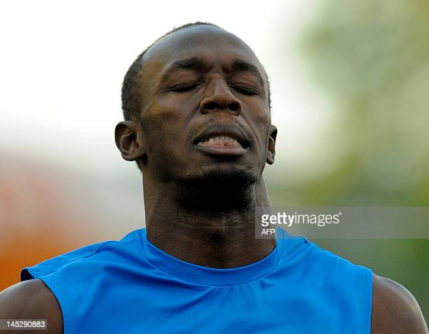 Usain Bolt of Jamaica reacts after competing in the men's 100m sprint on May 25 at the Zlata Tretra athletics meeting in the eastern Czech city of...