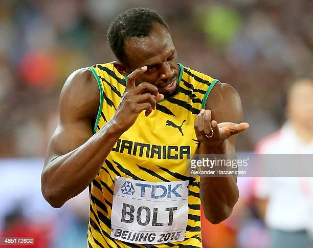 Usain Bolt of Jamaica reacts after competing in the Men's 200 metres heats during day four of the 15th IAAF World Athletics Championships Beijing...