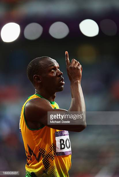 Usain Bolt of Jamaica reacts after competing in the Men's 200m Semifinals on Day 12 of the London 2012 Olympic Games at Olympic Stadium on August 8,...