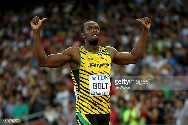 Usain Bolt of Jamaica reacts after crossing the finish line in the Men's 100 metres semi-final during day two of the 15th IAAF World Athletics...