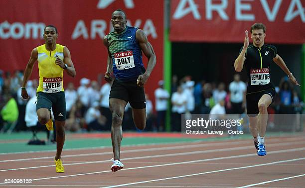 Usain Bolt of Jamaica reacts after he wins the Men's 200m during the Athletics Diamond League meeting at Stade de France stadium in Saint Denis north...