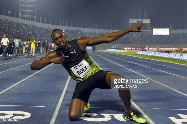 TOPSHOT Usain Bolt of Jamaica reacts after winning his final race in home country during the Racers Grand Prix at the national stadium in Kingston...