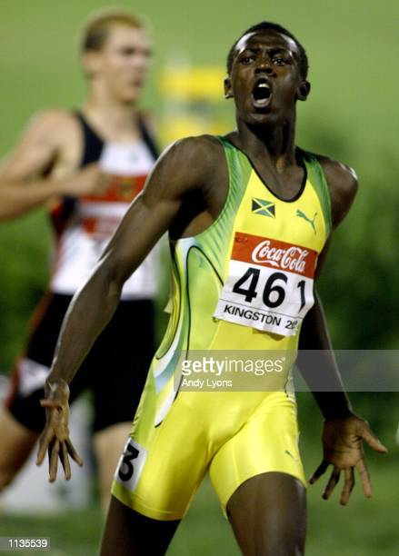 Usain Bolt of Jamaica reacts after winning the Mens 200 Meters during the IAAF Junior Athletics World Championships at the National Stadium on July18...