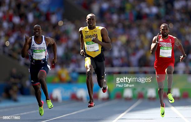Usain Bolt of Jamaica, Richard Thompson of Trinidad and Tobago and James Dasaolu of Great Britain compete in the Men's 100m Round 1 on Day 8 of the...