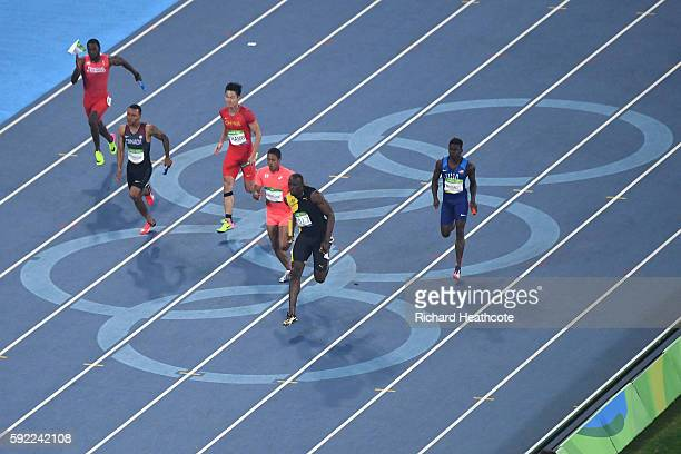 Usain Bolt of Jamaica runs ahead of of Aska Cambridge of Japan Trayvon Bromell of the United States and Andre De Grasse of Canada in the Men's 4 x...