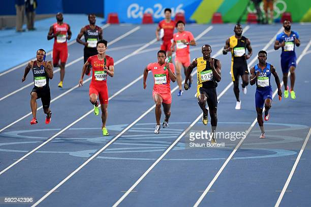 Usain Bolt of Jamaica runs ahead of of Aska Cambridge of Japan, Trayvon Bromell of the United States and Andre De Grasse of Canada in the Men's 4 x...