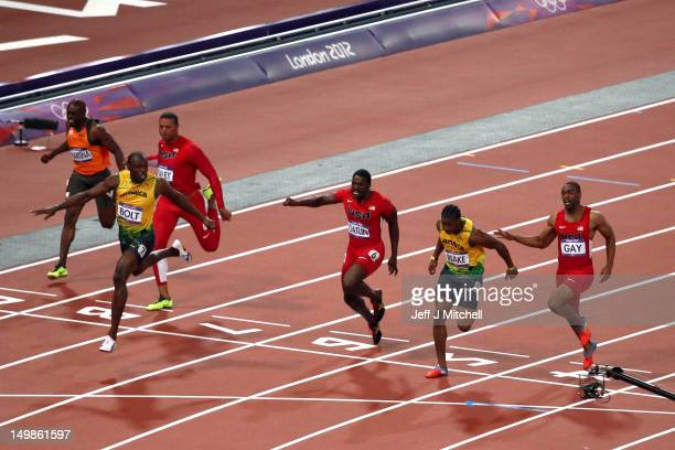 Usain Bolt of Jamaica runs ahead of Ryan Bailey of the United States Yohan Blake of Jamaica and Justin Gatlin of the United States during the Men's...