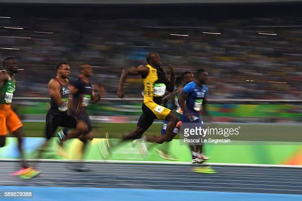 Usain Bolt of Jamaica runs on his way to winning the Men's 100 meter final over Justin Gatlin of the United States and Andre De Grasse of Canada on...