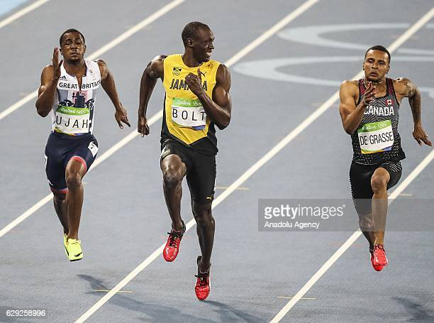 Usain Bolt of Jamaica smiles as he looks at Canada's Andre De Grasse in the Men's 100 meter semifinal of the Rio 2016 Olympic Games in Rio de Janeiro...