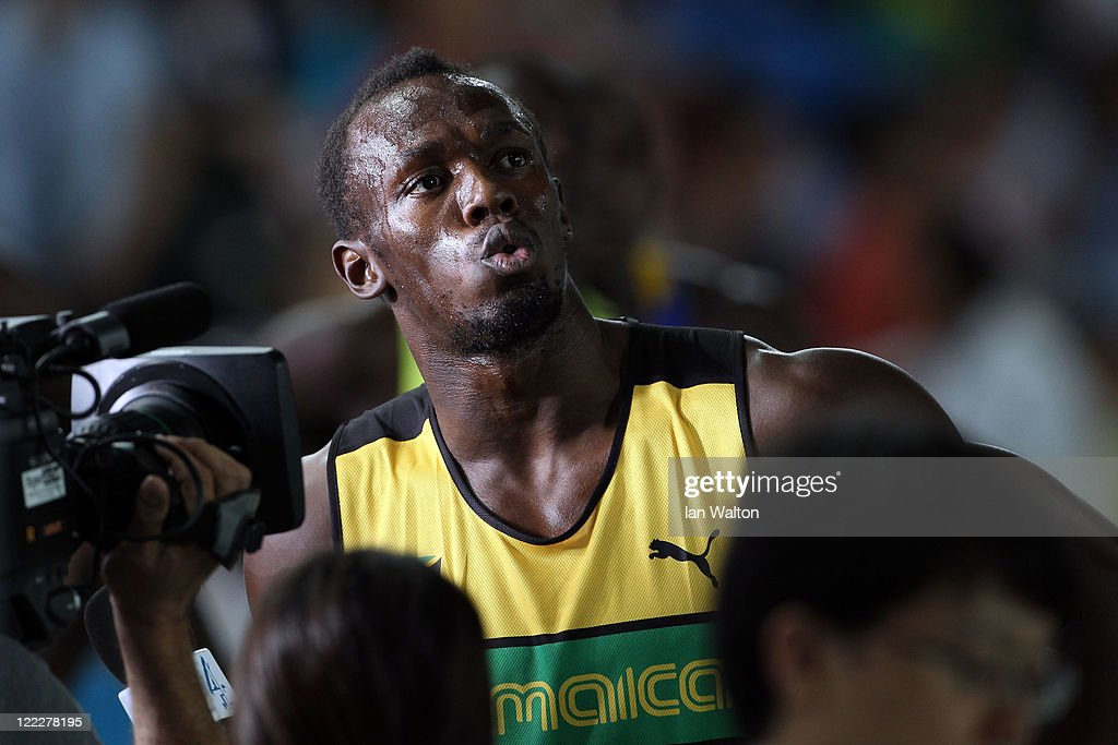 Usain Bolt of Jamaica speaks to the media after the men's 100 metres heats during day one of the 13th IAAF World Athletics Championships at the Daegu Stadium on August 27, 2011 in Daegu, South Korea.