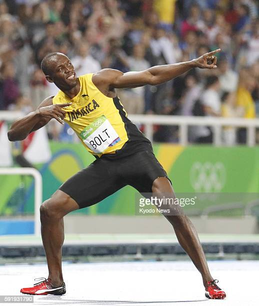 Usain Bolt of Jamaica strikes his signature Lightning Bolt pose after winning the gold medal in the men's 200 meters at the Rio de Janeiro Olympics...