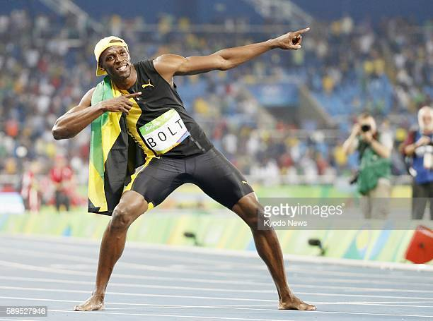 Usain Bolt of Jamaica strikes his trademark Lightning Bolt pose after winning the men's 100meter gold medal at the Rio Olympics on Aug 14 2016