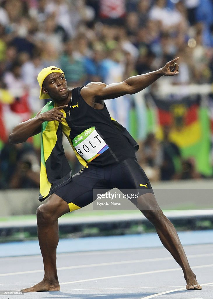 Usain Bolt of Jamaica strikes his trademark u0027Lightning Boltu0027 pose after winning the menu0027s & Kyodo News Pictures | Getty Images azcodes.com