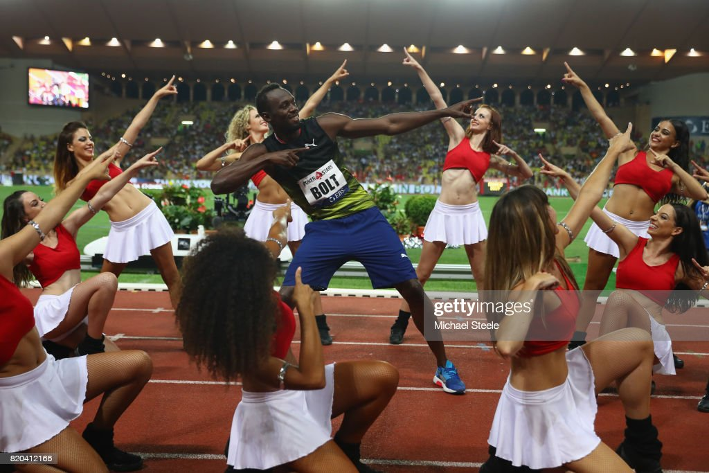 Usain Bolt of Jamaica struts his stuff alongside cheerleaders after victory in the men's 100m during the IAAF Diamond League Meeting Herculis on July 21, 2017 in Monaco, Monaco.