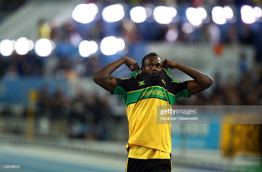 Usain Bolt of Jamaica takes his top off priorto the men's 100 metres heats during day one of the 13th IAAF World Athletics Championships at the Daegu Stadium on August 27, 2011 in Daegu, South Korea.