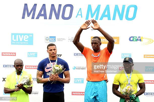Usain Bolt of Jamaica takes the medal podium after winning the Mano a Mano Athletics Challenge at Jockey Club Brasileiro on April 19 2015 in Rio de...