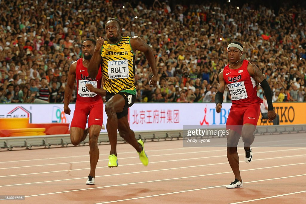 Usain Bolt of Jamaica (C) wins gold ahead of Tyson Gay of the United States (L) and Mike Rodgers of the United States during the Men's 100 metres final during day two of the 15th IAAF World Athletics Championships Beijing 2015 at Beijing National Stadium on August 23, 2015 in Beijing, China.