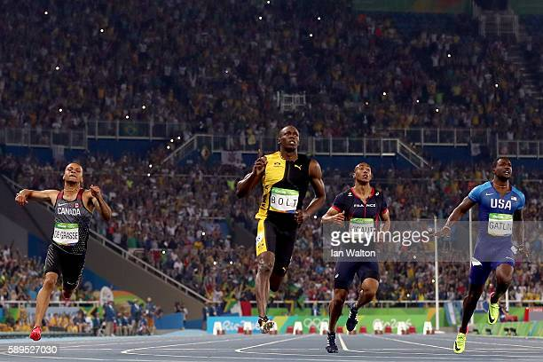 Usain Bolt of Jamaica wins the Men's 100m Final ahead of Andre De Grasse of Canada and Justin Gatlin of the United States on Day 9 of the Rio 2016...