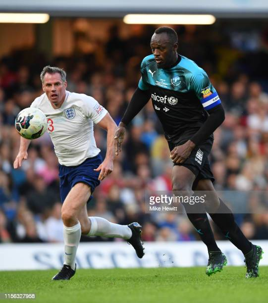 Usain Bolt of Soccer Aid World XI takes on Jamie Carragher of England during the Soccer Aid for UNICEF 2019 match between England and the Soccer Aid...
