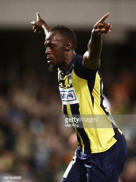 Usain Bolt of the Mariners celebrates scoring a goal during the preseason friendly match between the Central Coast Mariners and Macarthur South West...