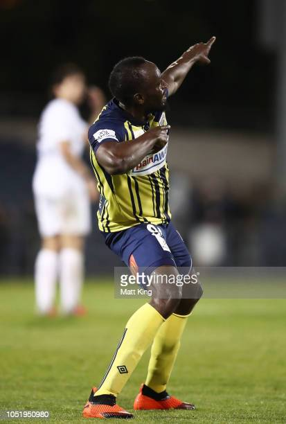 Usain Bolt of the Mariners celebrates scoring his first goal during the preseason friendly match between the Central Coast Mariners and Macarthur...