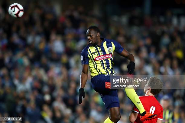 Usain Bolt of the Mariners heads the ball towards goal during the preseason match between the Central Coast Mariners and Central Coast Football at...