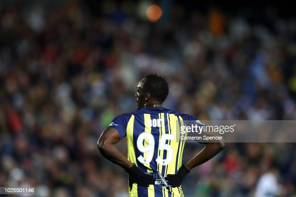 Usain Bolt of the Mariners looks on during the preseason match between the Central Coast Mariners and Central Coast Football at Central Coast Stadium...