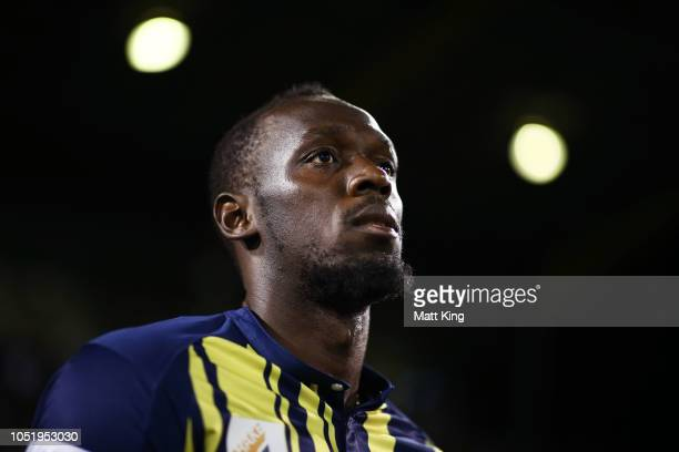 Usain Bolt of the Mariners walks onto the pitch during the preseason friendly match between the Central Coast Mariners and Macarthur South West...