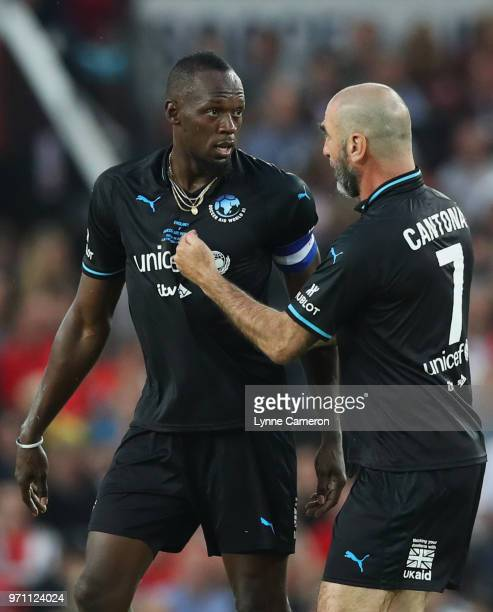 Usain Bolt of the Rest of the World and Eric Cantona of the Rest of the World in discussion during the Soccer Aid for UNICEF 2018 match between...