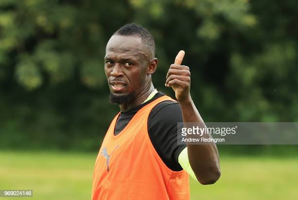 Usain Bolt of the Rest of the World gives a thumbs up as he takes part in training during a Soccer Aid for UNICEF media session at Fulham FC training...