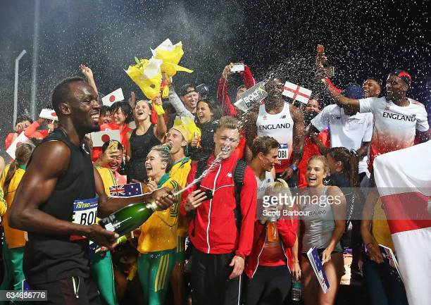 Usain Bolt of Usain Bolt's AllStar team celebrates with champagne after winning the event during the Melbourne Nitro Athletics Series at Lakeside...