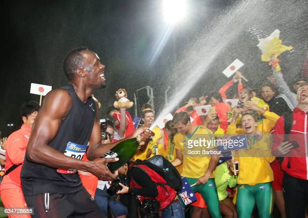 Usain Bolt of Usain Bolt's AllStar team sprays champagne on the teams from England and Australia after Usain Bolt's AllStar team won the event during...