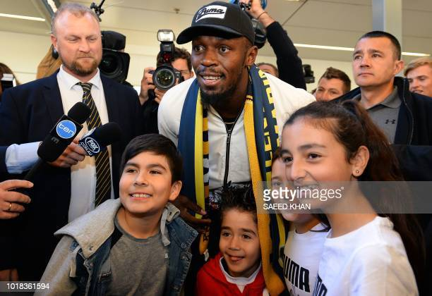 TOPSHOT Usain Bolt poses for pictures with fans upon arrival at Sydney international airport on August 18 2018 Bolt 31yearold eighttime Olympic...