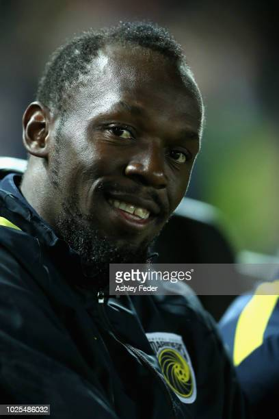 Usain Bolt reacts from the bench during the preseason match between the Central Coast Mariners and Central Coast Football at Central Coast Stadium on...
