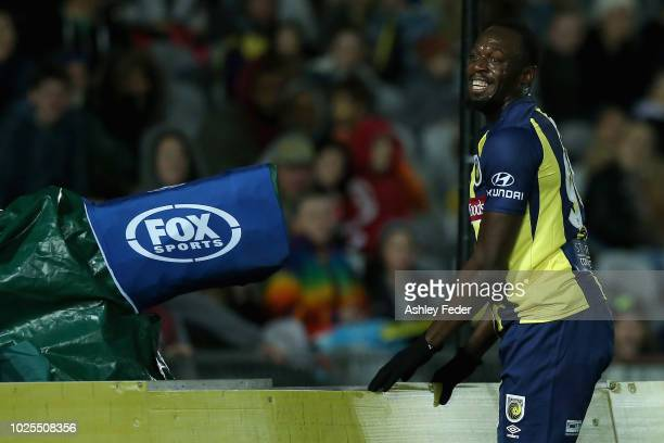 Usain Bolt reacts to a near miss at goal during the preseason match between the Central Coast Mariners and Central Coast Football at Central Coast...
