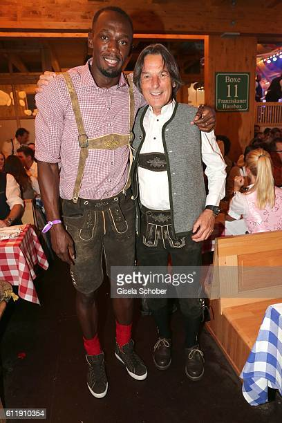 Usain Bolt sprinter ninefold olympic champion and elevenfold world champion and Dr HansWilhelm MuellerWohlfahrt during the Oktoberfest at...