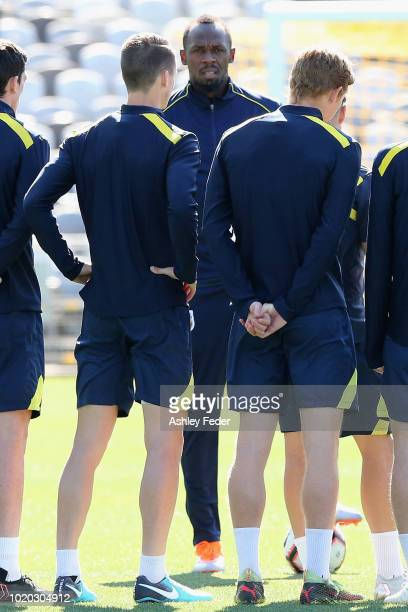 Usain Bolt warms up during Usain Bolt's first training session with the Central Coast Mariners ALeague squad at Central Coast Stadium on August 21...
