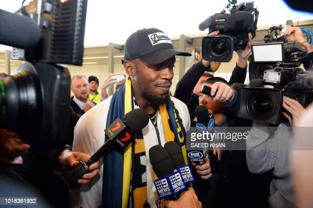 TOPSHOT Usain Bolt talks to the media upon arrival at Sydney international airport on August 18 2018 Bolt 31yearold eighttime Olympic champion...