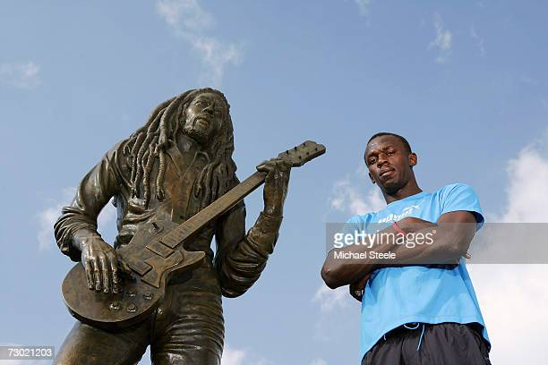 Usain Bolt the 200m and 400m sprinter poses in front of the Bob Marley statue outside the National Stadium on October 17 2006 in Kingston Jamaica