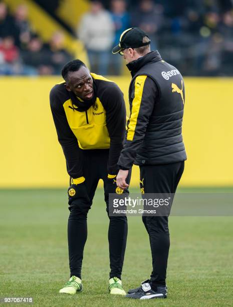 Usain Bolt together with Peter Stoeger head coach of Borussia Dortmund during the training session at the training ground on March 23 2018 in...