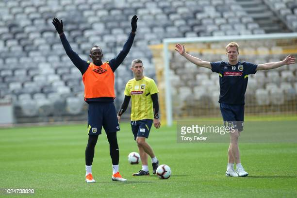 Usain Bolt trains with Nick Montgomery and Matt Simon during a Central Coast Mariners training session at Central Coast Stadium on August 28 2018 in...