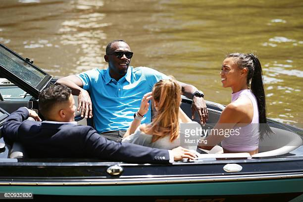 Usain Bolt travels by boat with Australian Olympians Anneliese Rubie and Morgan Mitchell as well as John Steffensen to the launch of Nitro Athletics...