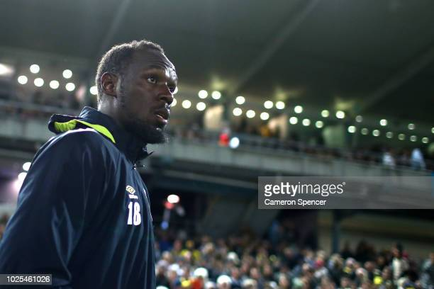 Usain Bolt walks onto the pitch during the preseason match between the Central Coast Mariners and Central Coast Football at Central Coast Stadium on...
