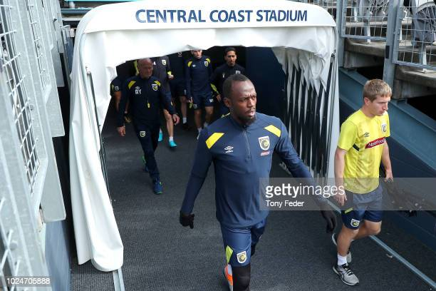 Usain Bolt walks out to start training during a Central Coast Mariners training session at Central Coast Stadium on August 28, 2018 in Gosford,...